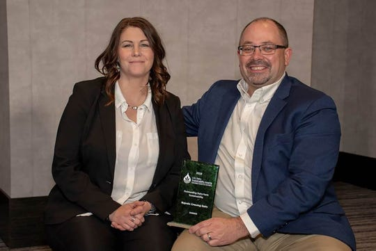 Wisconsin dairy farmer Dean Strauss, Majestic Crossing Dairy, wins one of three national Outstanding Dairy Farm Sustainability Awards at the eighth annual U.S. Dairy Sustainability Award ceremony on May 8 in Rosemont, Illinois. Pictured are Kris and Dean Strauss.