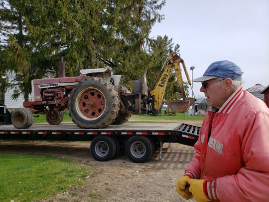 Bob watched at his IH 1206 was loaded on the flatbed.