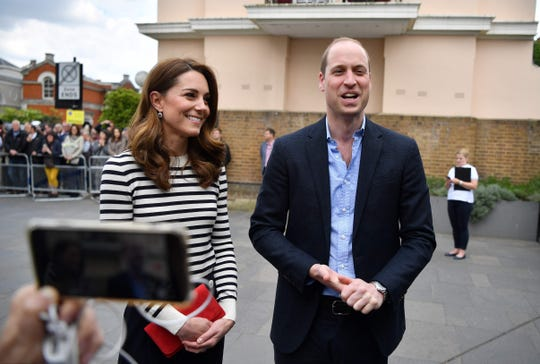 Prince William and Kate, Duchess of Cambridge, talk to reporters about their delight over their newborn nephew as they arrive to launch the King's Cup Regatta at the Cutty Sark in Greenwich, southeast London on May 7, 2019.