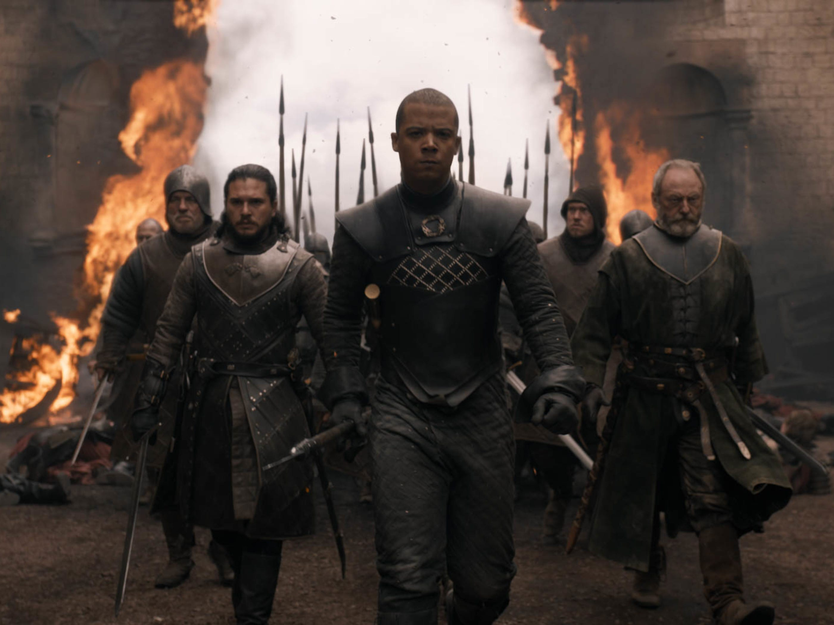 Jon Snow (Kit Harington), left, Grey Worm (Jacob Anderson) and Davos Seaworth (Liam Cunningham) march into King's Landing after Drogon burns the gate.