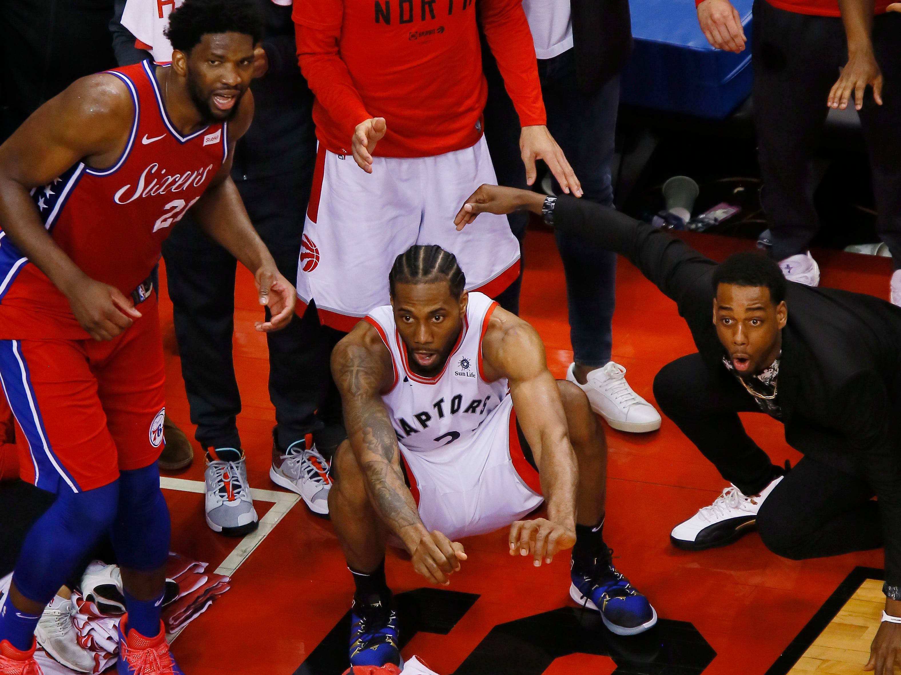 May 12: Kawhi Leonard (2) and Joel Embiid (21) watch as Leonard's game-winning shot falls to lift the Raptors over the Sixers.