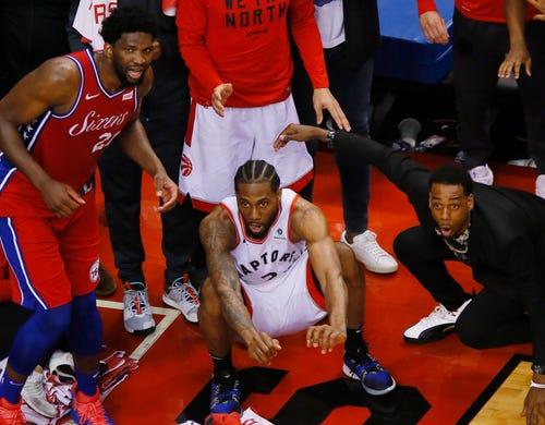 May 12: Kawhi Leonard (2) and Joel Embiid (21) watch as Leonard's game-winning shot falls to lift the Raptors over the Sixers.