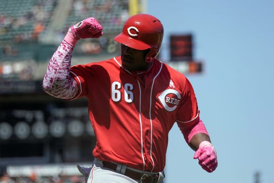 Yasiel Puig flexes after hitting a solo home run off Madison Bungarner in the sixth inning.