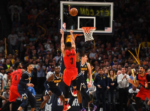 May 12: Blazers guard C.J. McCollum puts up a late shot during Game 7 against the Nuggets in Denver.