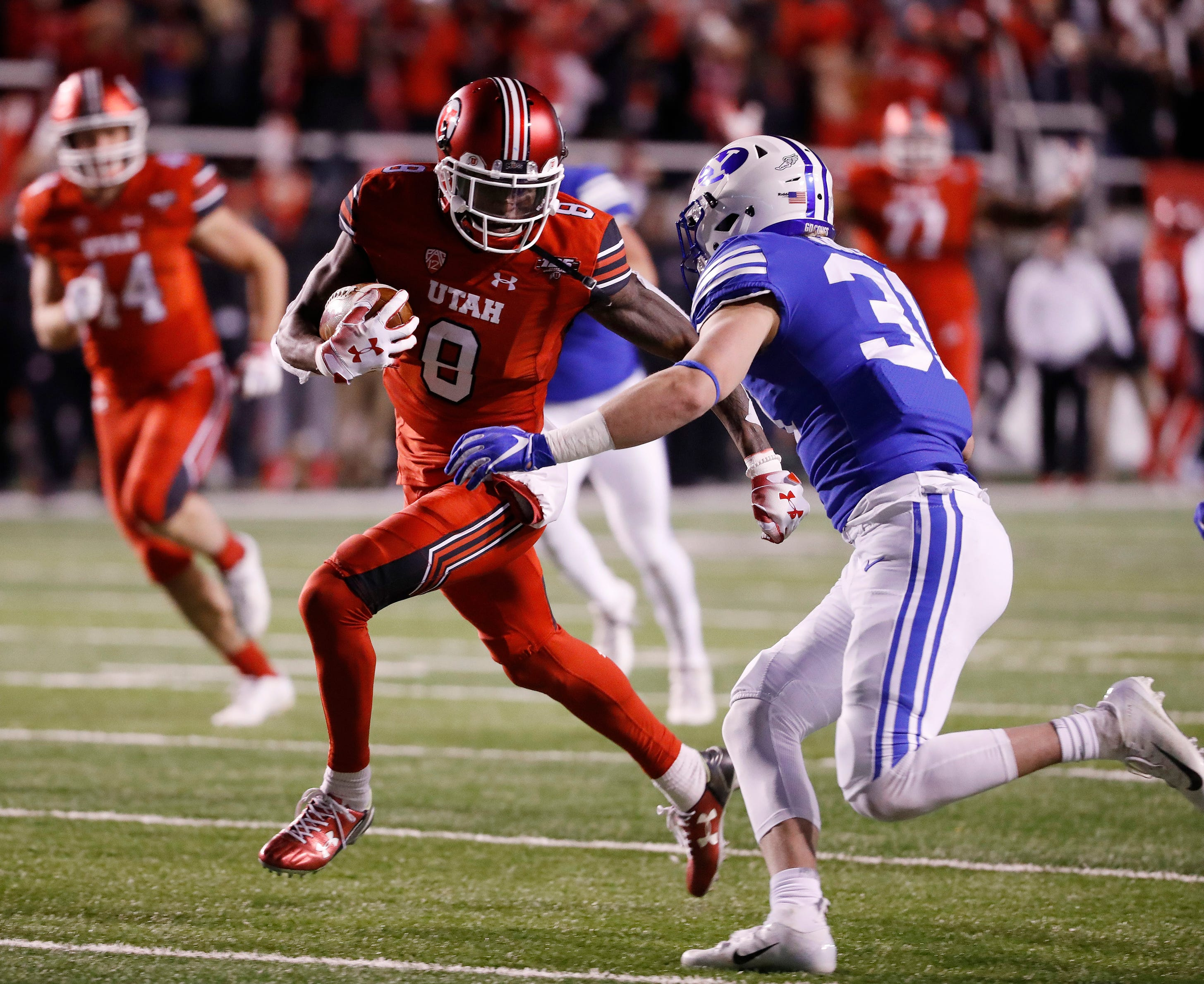 Utah wide receiver Siaosi Mariner  runs for a first down after a reception against Brigham Young during their game in 2018.