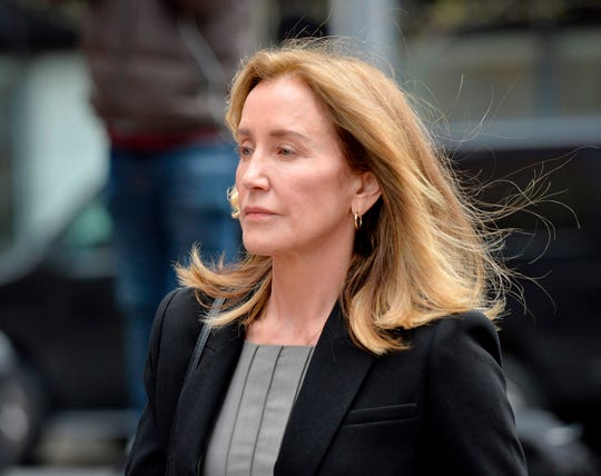 Actress Felicity Huffman arrives at John Joseph Moakley United States Courthouse in Boston, Massachusetts, May 13, 2019.