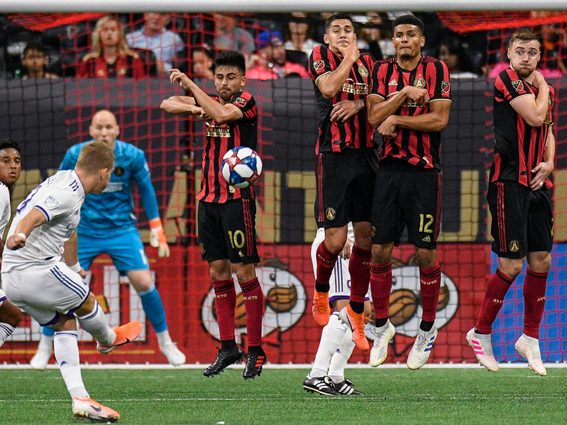 May 12: Atlanta United players try to block a penalty kick by Orlando City forward Chris Mueller during the second half at Mercedes-Benz Stadium. Atlanta won the game, 1-0.