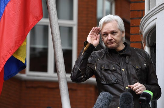 Wikileaks founder Julian Assange speaks to reporters on the balcony of the Ecuadorian Embassy in London, on May 19 May 2017.