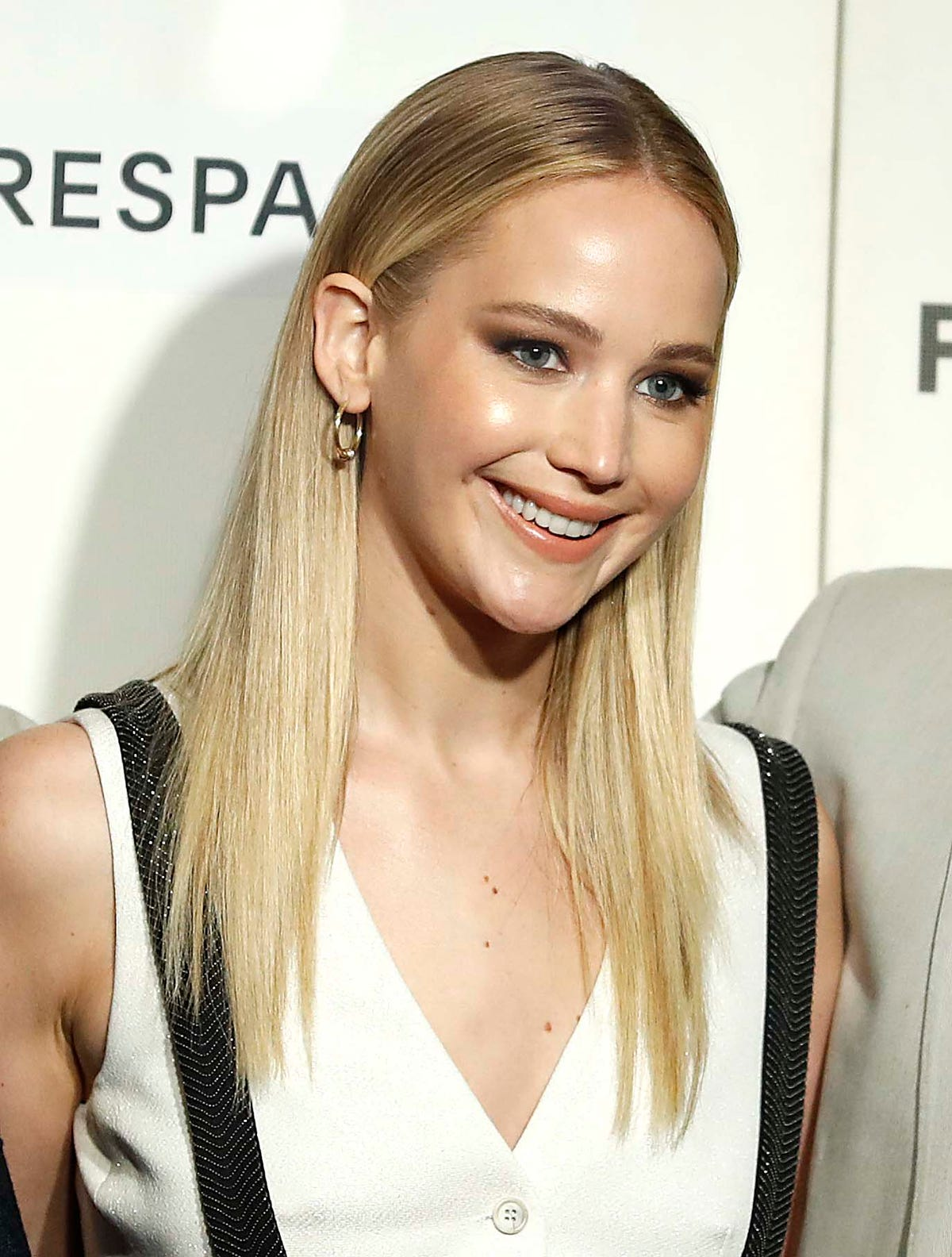 2740b780ade37 Jennifer Lawrence looks like a blushing bride at engagement party