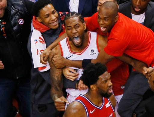 May 12: Kawhi Leonard celebrates after hitting winning shot at the buzzer to lift the Raptors over the Sixers in Game 7 and send Toronto to the Eastern Conference finals.
