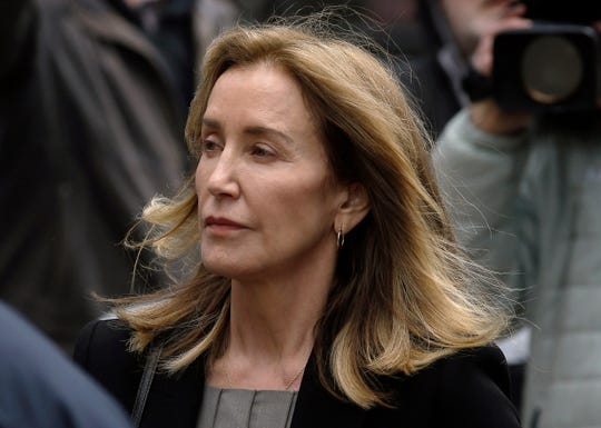 Felicity Huffman arrives at federal court May 13 in Boston, where she pleaded guilty to charges in a nationwide college admissions bribery scandal.