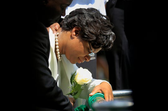 Sandra Bland's sister Sharon Cooper kneels at Bland's burial site at the Mt. Glenwood Memorial Gardens West cemetery on July 25, 2015, in Willow Springs, Illinois.