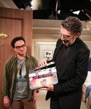 'The Big Bang Theory' co-creator Chuck Lorre, right, handles the slate marking the final taped scene of the 12-season CBS comedy as actor Johnny Galecki watches.