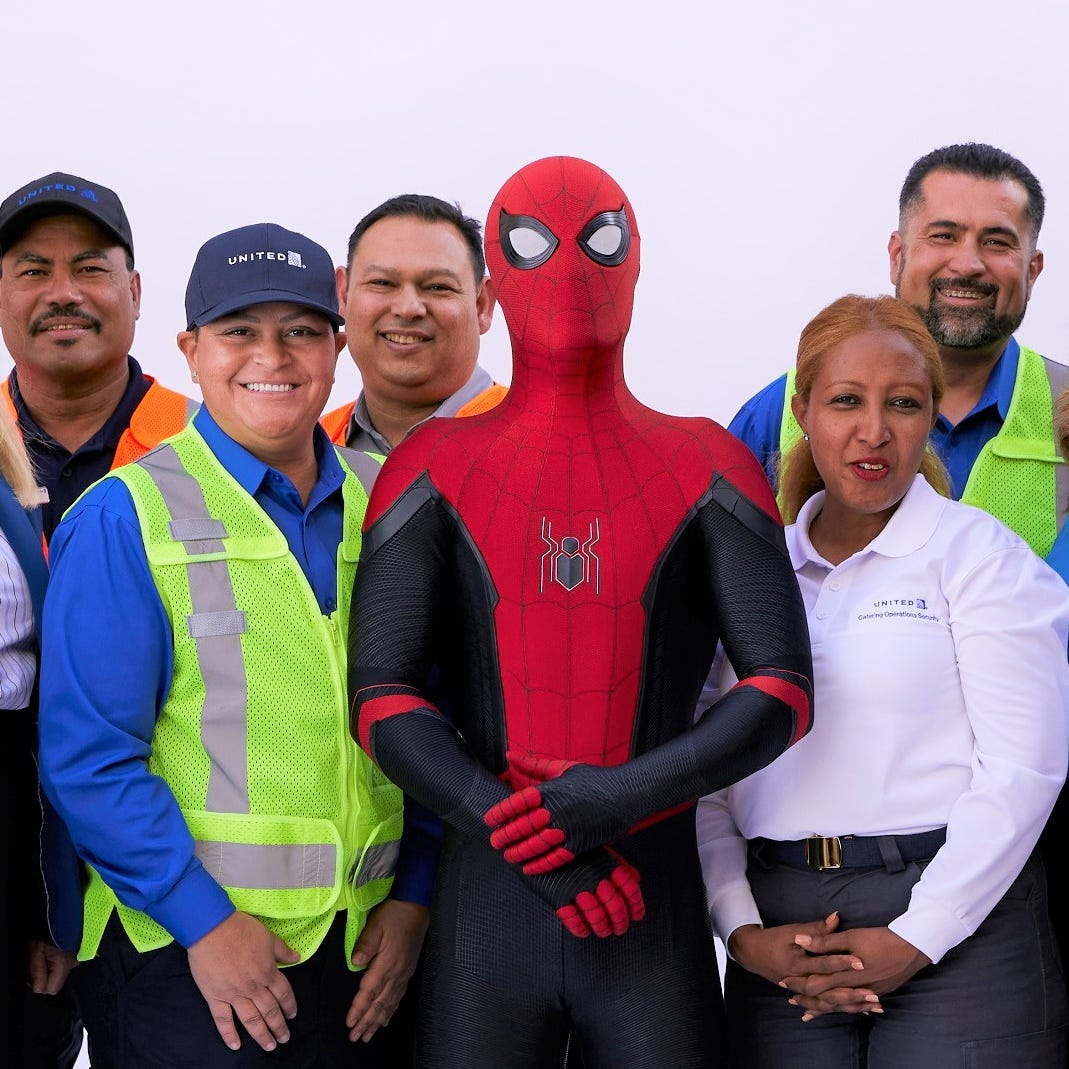 Spider-Man poses with United employees seen in the new safety video.