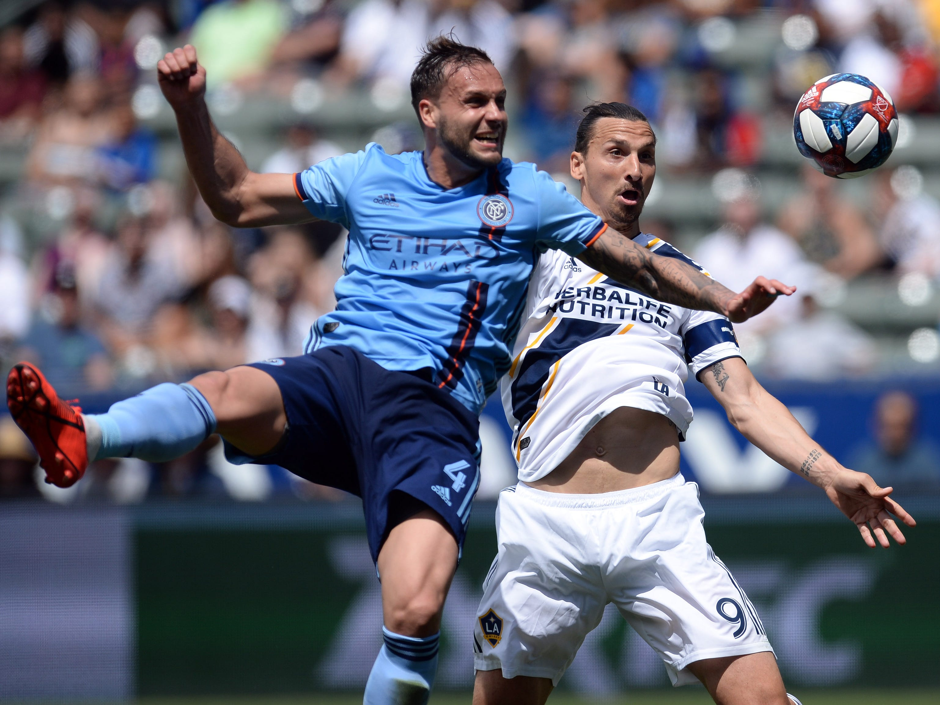 May 11:  Los Angeles Galaxy forward Zlatan Ibrahimovic (9) plays for the ball against New York City defender Maxime Chanot (4) during the second half at StubHub Center. NYCFC won the game, 2-0.
