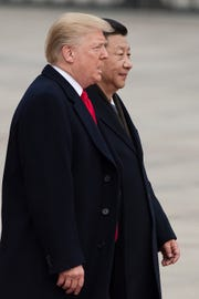 Presidents Donald Trump and Xi Jinping in Beijing in 2017.