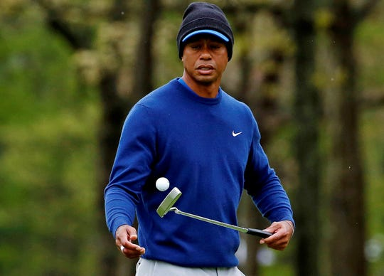 Tiger Woods takes part in a practice round for the PGA Championship at Bethpage.
