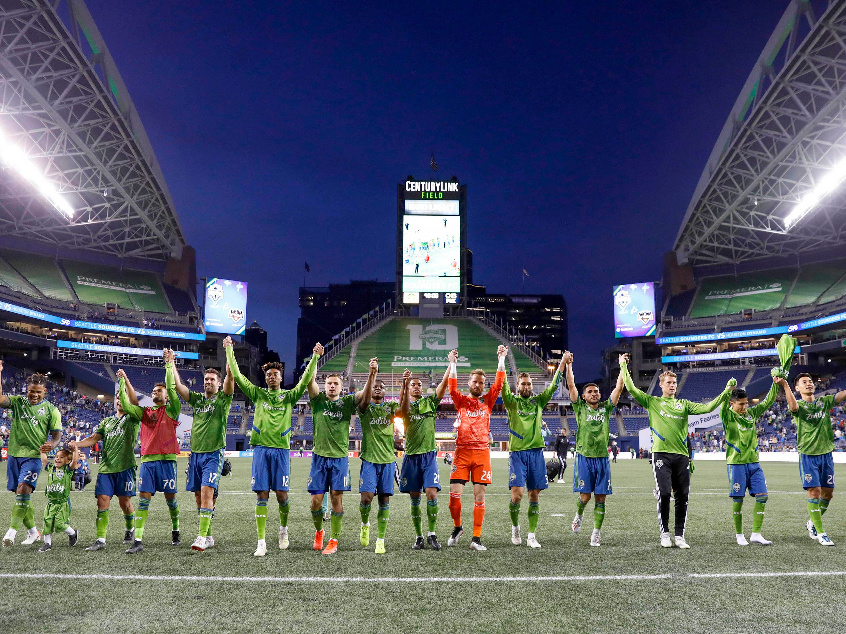 May 11: Seattle Sounders FC players take a bow to their supporters following a 1-0 victory against the Houston Dynamo at CenturyLink Field.