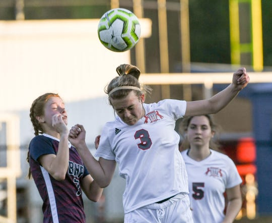Maggie Magruder of Palmetto High School heads a ball near a Belton-Honea Path opponent in Honea Path Wednesday, April 10, 2019.