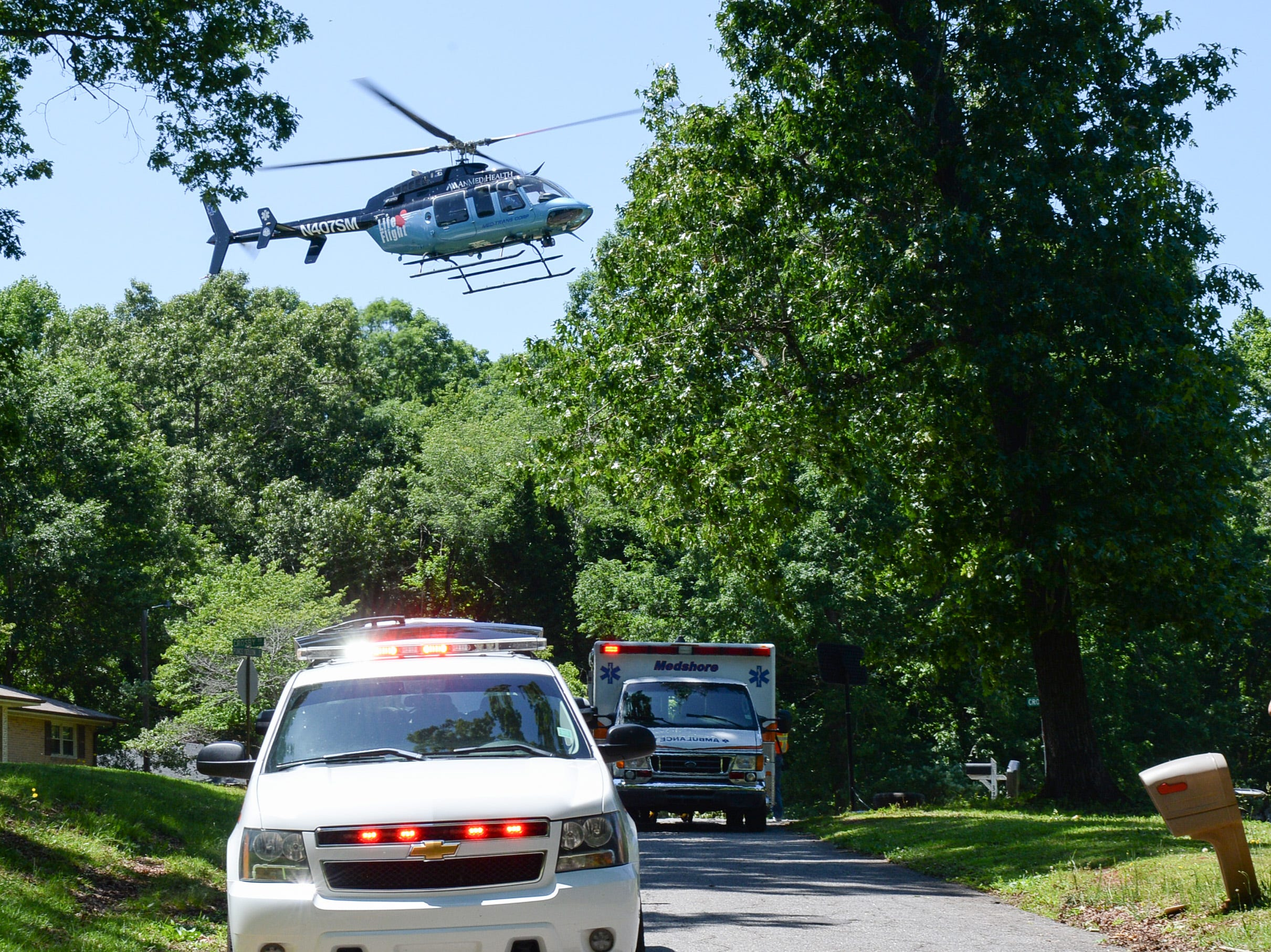 LifeFlight helicopter flies a young woman who crashed her motorcycle into a tree in Anderson Tuesday. Homeland Park firemen and Medshore also responded to the accident.