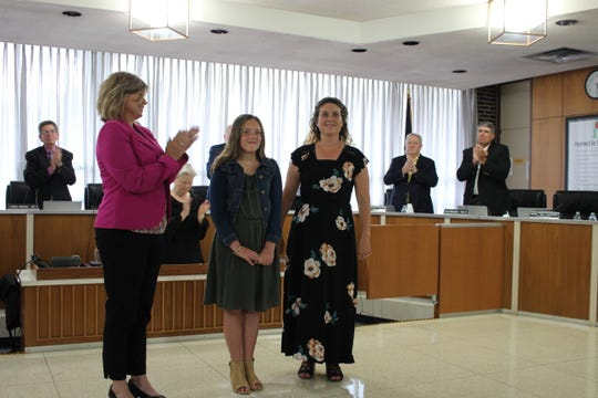Mallory Byrd (center) stands next to her mother, Jennifer Byrd (right) and Hayden R. Lawrence Upper Elementary School Assistant Principal Kristie Tyler (left) while being recognized at a Rapides Parish School Board meeting. The fifth-grader was selected as Louisiana's 2019 elementary school student of the year.