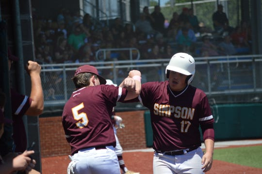 Simpson's Landon Meyers (17) celebrates with Zach Albritton after scoring a run against Summerfield Monday.