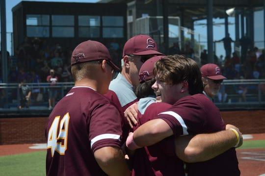 Simpson's Zach Albritton (right) hugs coach Austin Cox after the Broncos won the Class C championship game Monday.