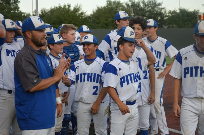Pitkin coach JC Holt (left) is overcome with emotions after the Tigers won the Class B championship game Monday. Holt was named as the Class B baseball Coach of the Year by the Louisiana Baseball Coaches Association.