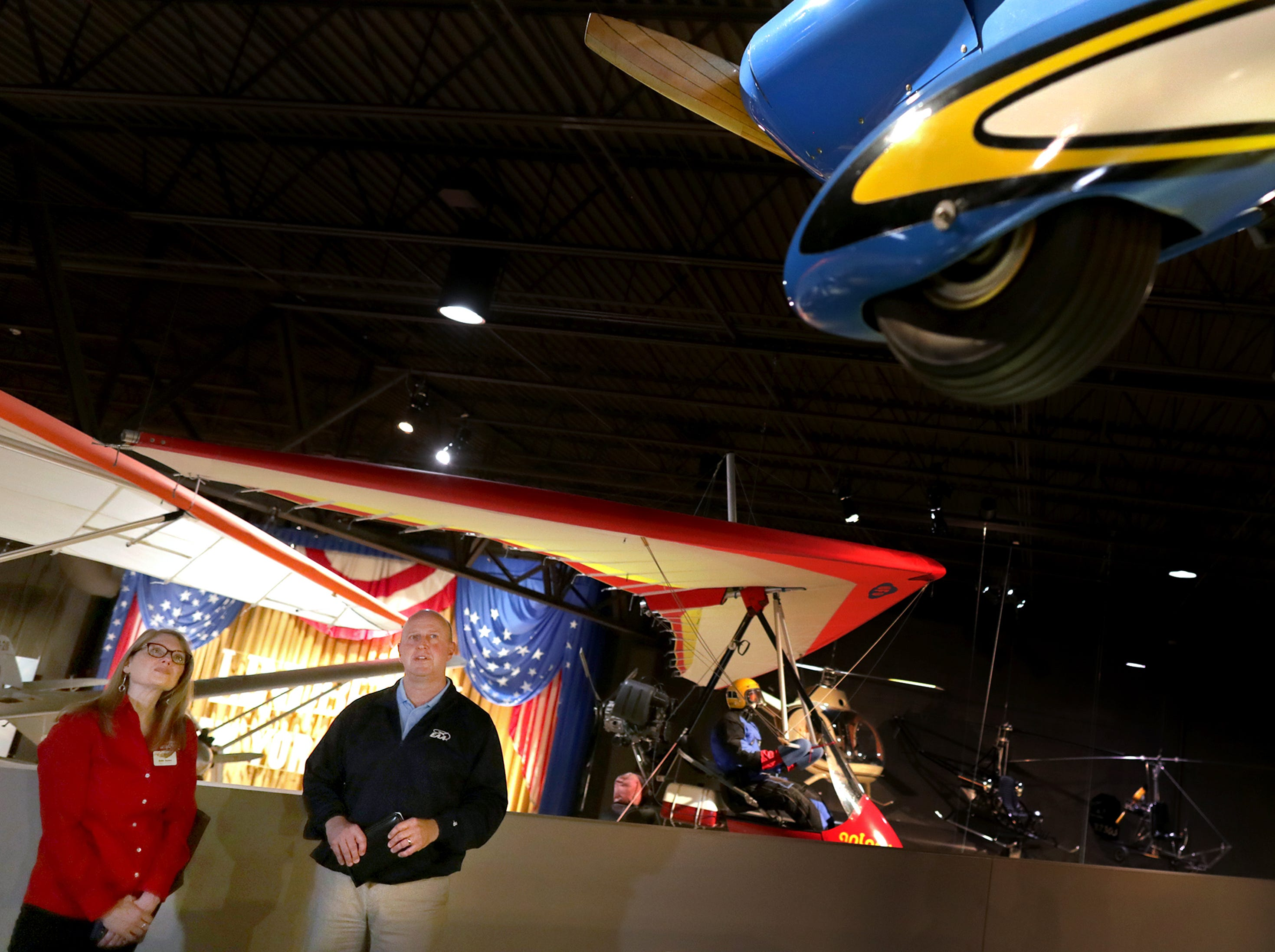 Dick Knapinski, EAA  Director of Communications, gives a museum tour to Wisconsin Deputy Secretary of Tourism Anne Sayersmduring a visit at the EAA Aviation Museum on Monday, May 6, 2019, in Oshkosh, Wis.