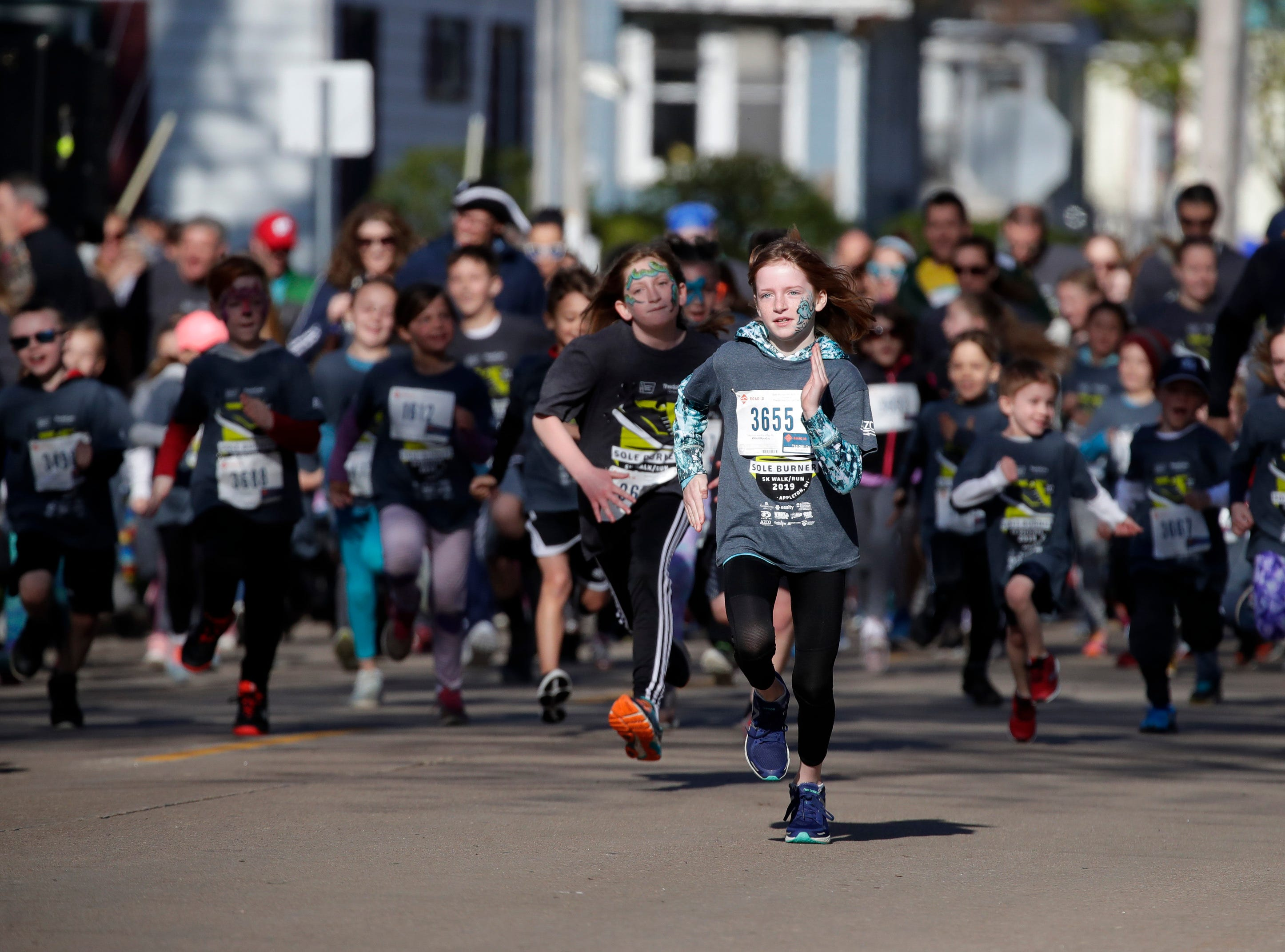 Racers in the children's fun run take off from the starting line during the Sole Burner 5K Walk-Run Saturday, May 11, 2019, in Appleton, Wis. 