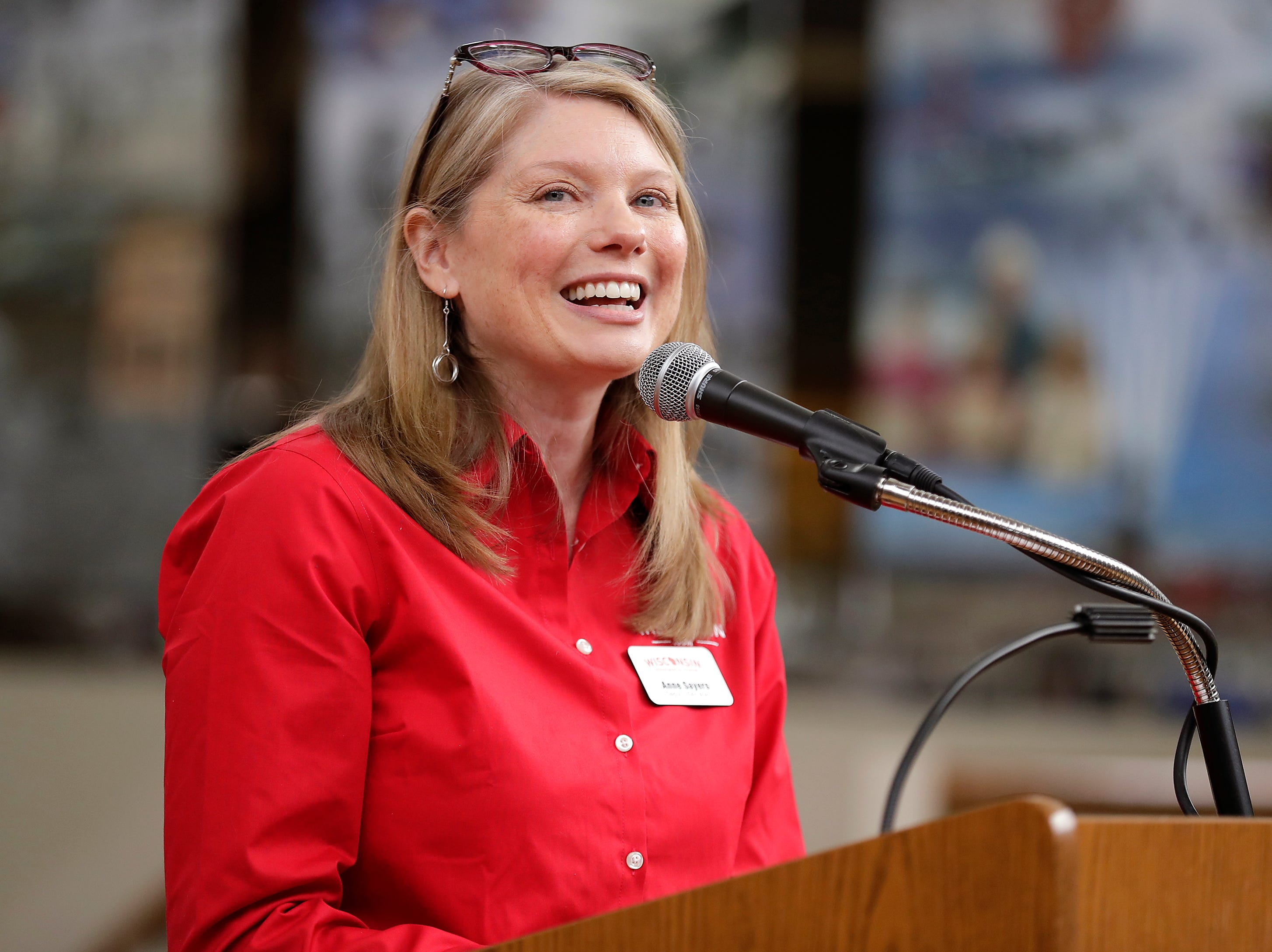 Wisconsin Deputy Secretary of Tourism Anne Sayers speaks during a visit at the EAA Aviation Museum on Monday, May 6, 2019, in Oshkosh, Wis.