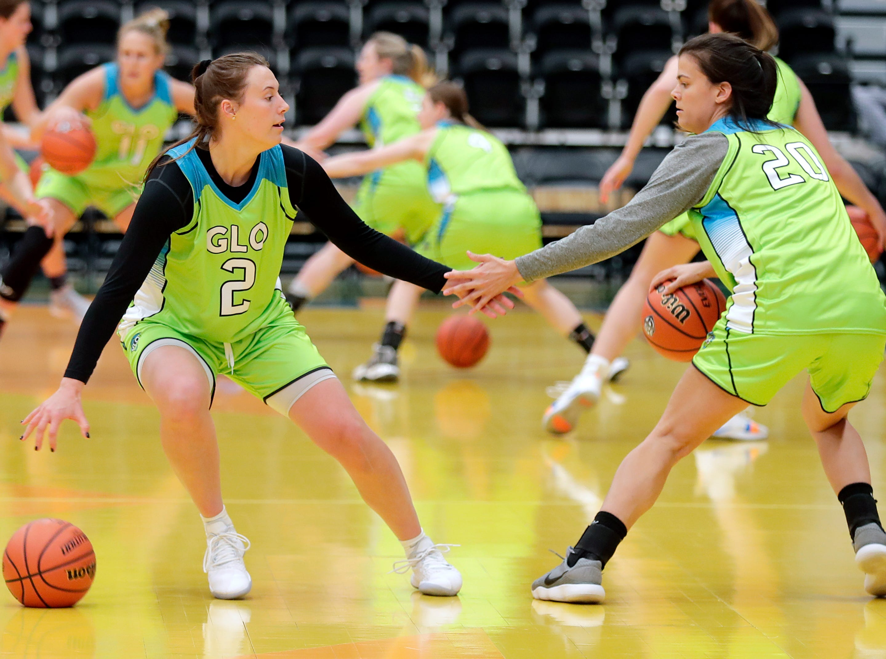 Wisconsin Glo's #2 Mehryn Kraker and #20 Gaby Bronson run a drill duriong a practice at Menominee Nation Arena on Tuesday, May 7, 2019, in Oshkosh, Wis. The Wisconsin Glo is a professional women's basketball team, they will play their first game on Friday, May 10, 2019 in Oshkosh. 
