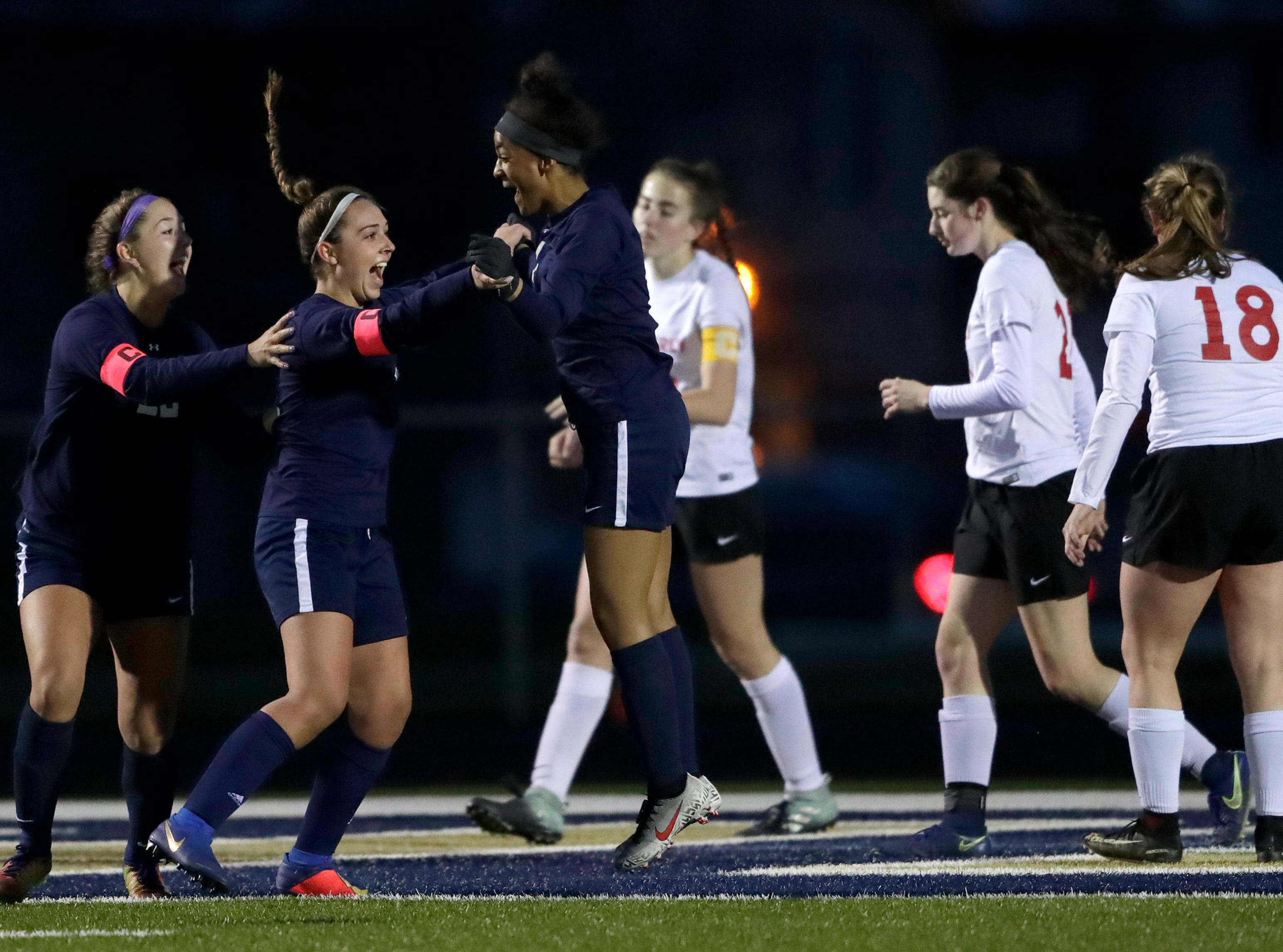 Appleton North High School's Abbie Schaefer, center, celebrates scoring a goal with teammates Taylor Tomoda, left, and Izzie Ruzzicone, right, against Kimberly High School during their girls soccer game Thursday, May 9, 2019, in Appleton, Wis. 