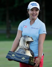 Sei Young Kim of South Korea poses with the trophy after winning the Thornberry Creek LPGA Classic last July in Hobart.
