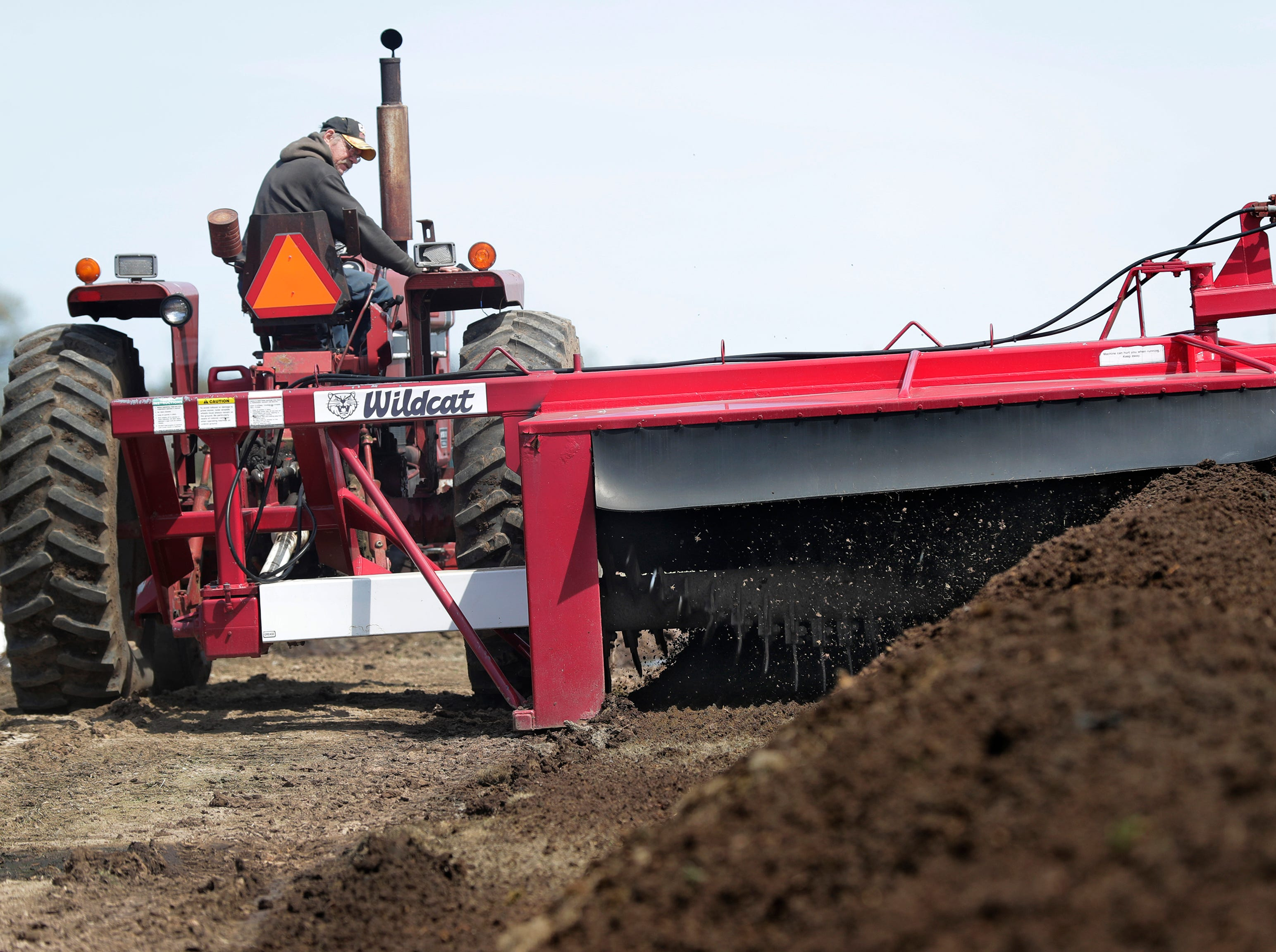 Steve Petersen turns compost to aerate it so that the bacteria can break the cow manure on The Petersen Dairy Farm Tuesday, May 7, 2019, in Grand Chute, Wis. 