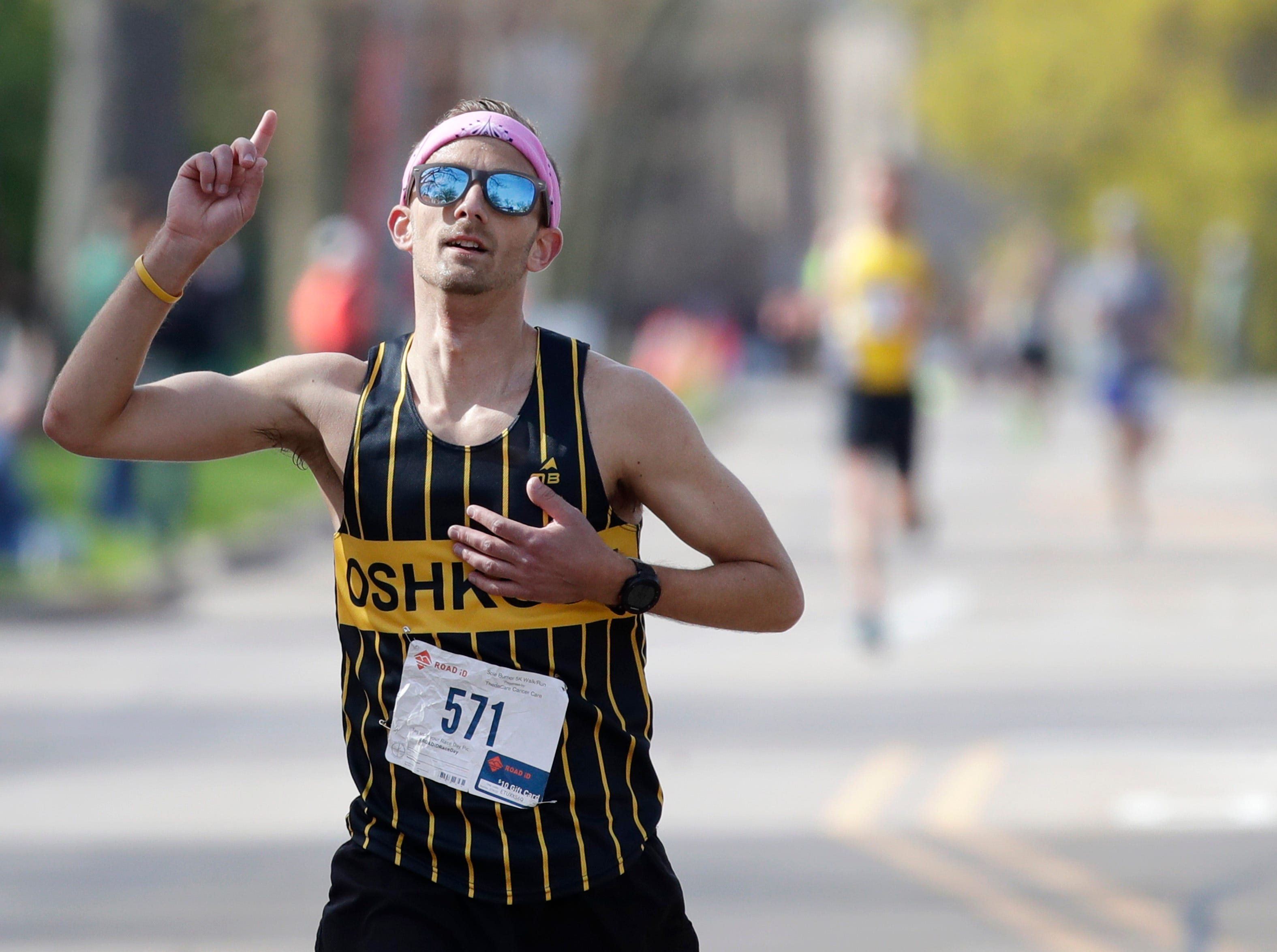 Erik Hofferber, of Neenah, takes first place in the Sole Burner 5K Walk-Run Saturday, May 11, 2019, in Appleton, Wis. 