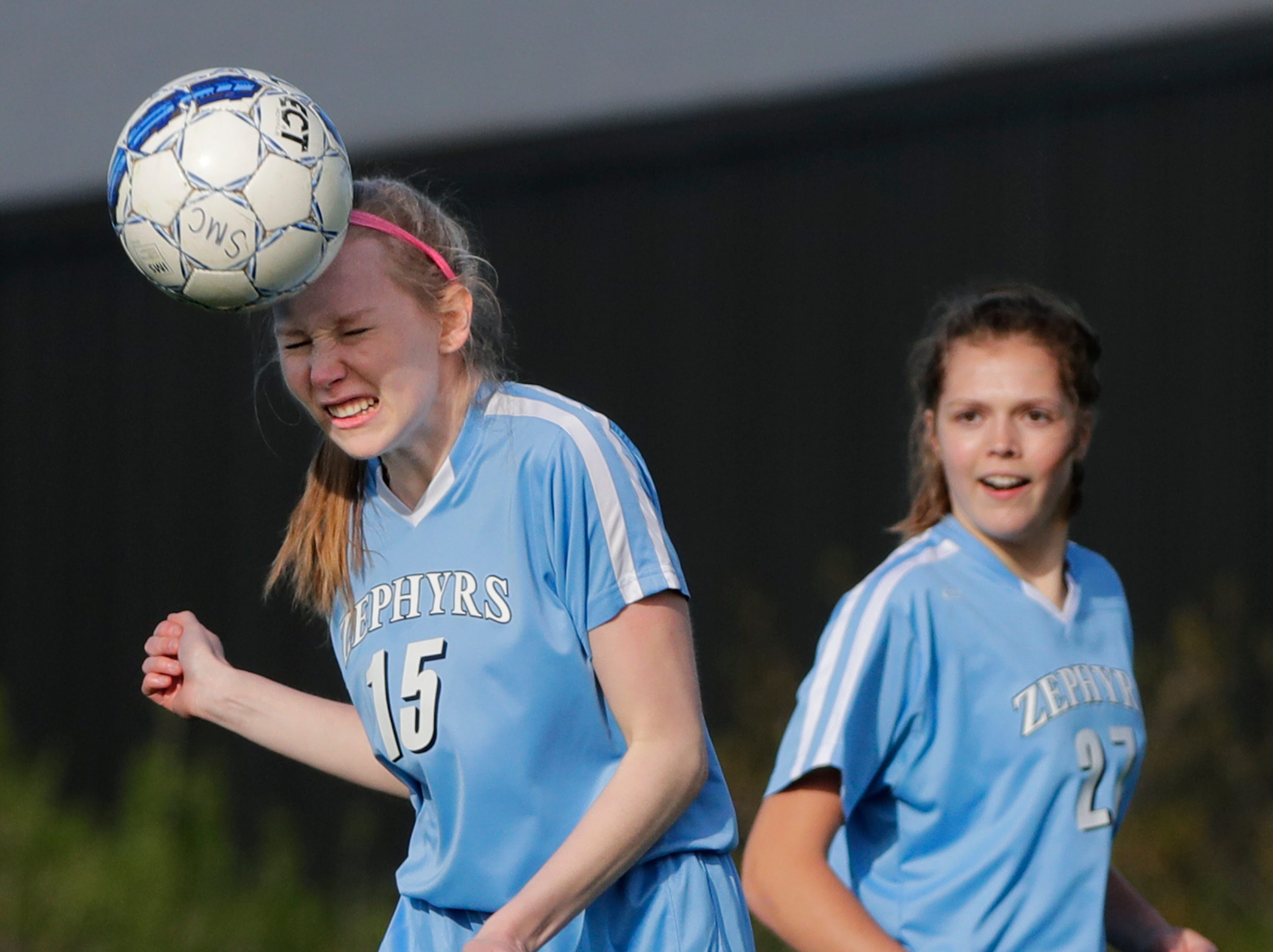St. Mary Catholic High School's Sophie Taubel (15) heads the ball against Roncalli High School during their girls soccer game Tuesday, May 7, 2019, in Fox Crossing, Wis. 
