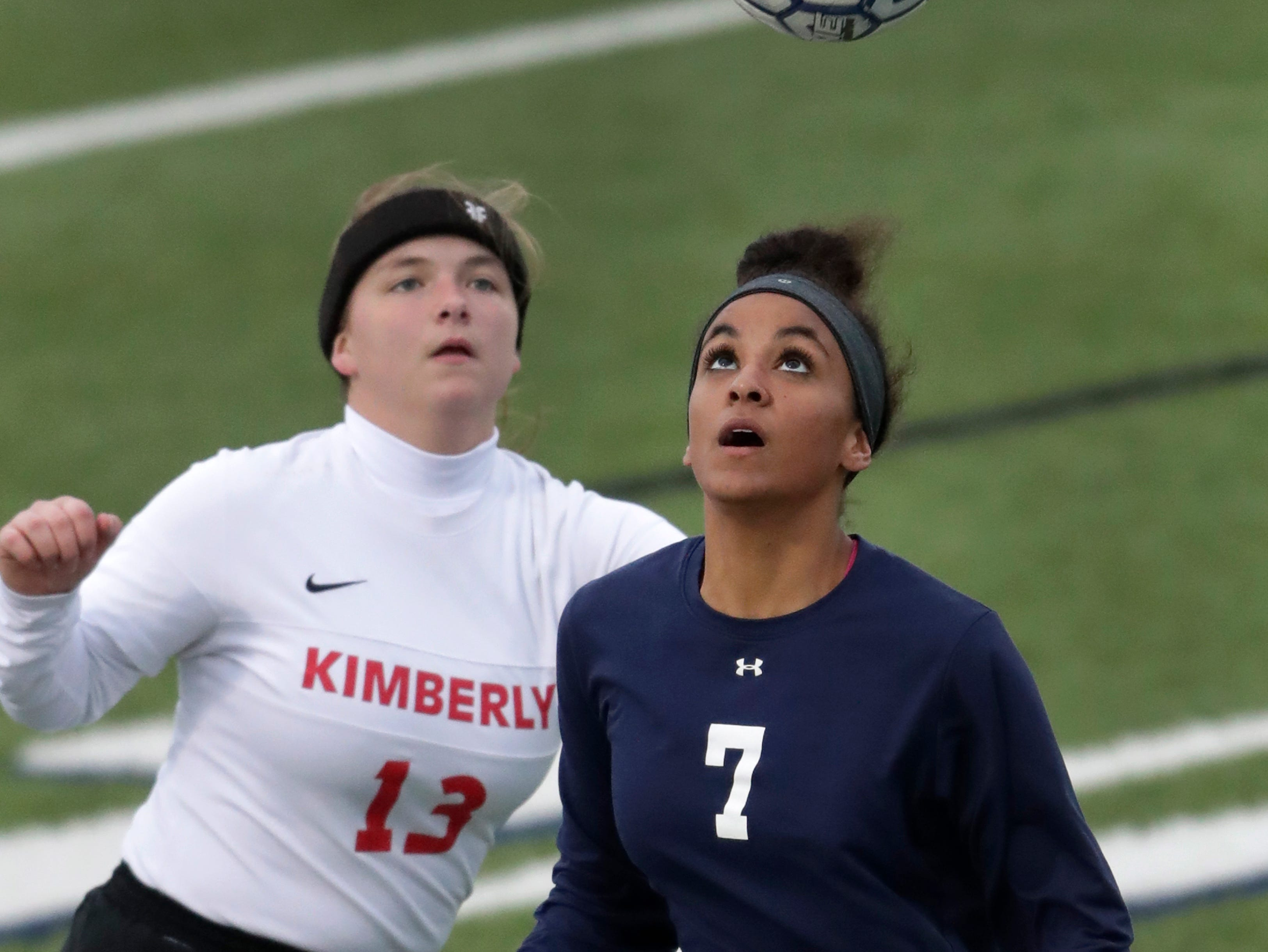 Appleton North High School's Izzie Ruzzicone (7) tries to control a throw in against Kimberly High School's Autumn Stage (13) during their girls soccer game Thursday, May 9, 2019, in Appleton, Wis. 