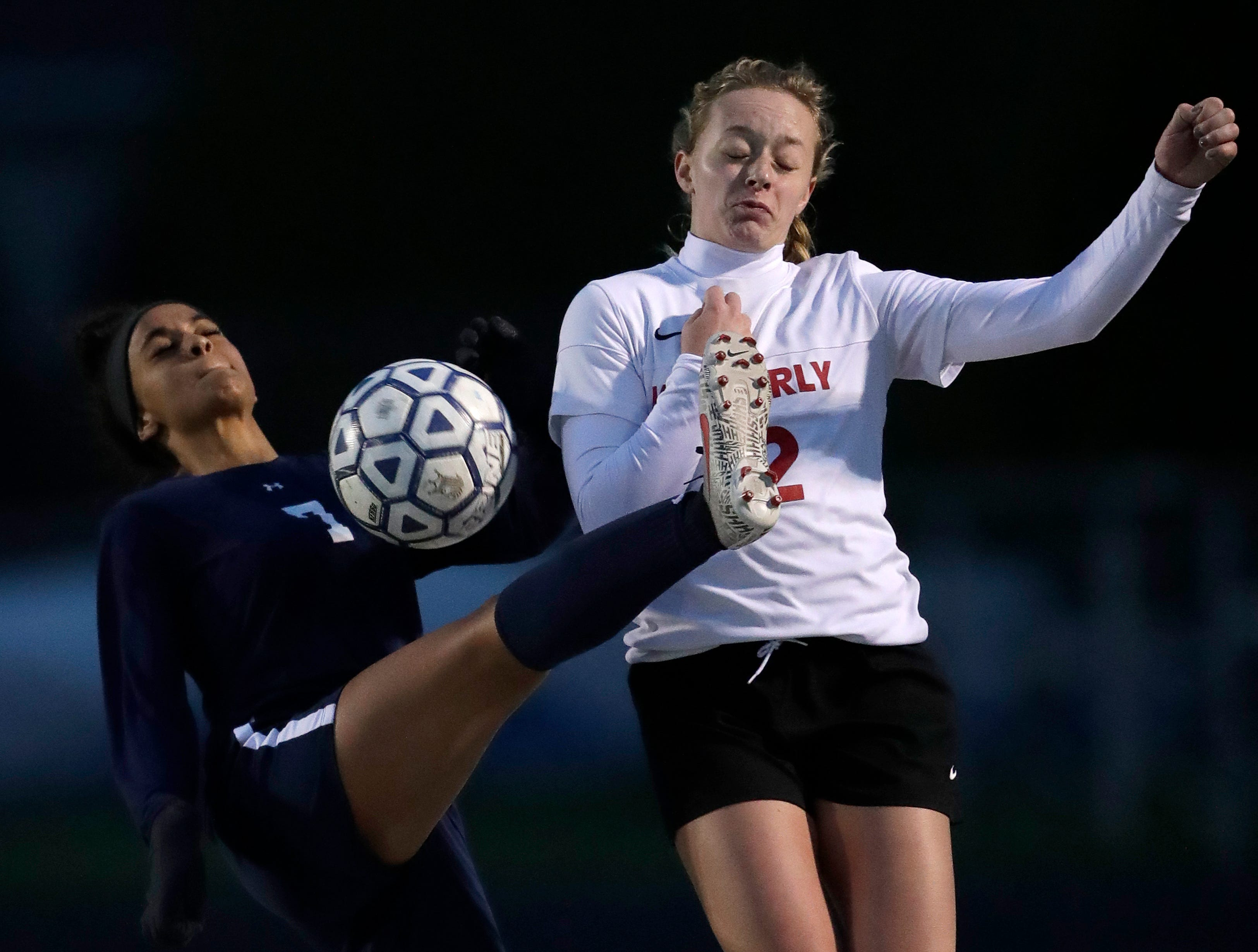 Appleton North High School's Izzie Ruzzicone (7) controls the ball against Kimberly High School's Lauryn Hull (12) during their girls soccer game Thursday, May 9, 2019, in Appleton, Wis. 