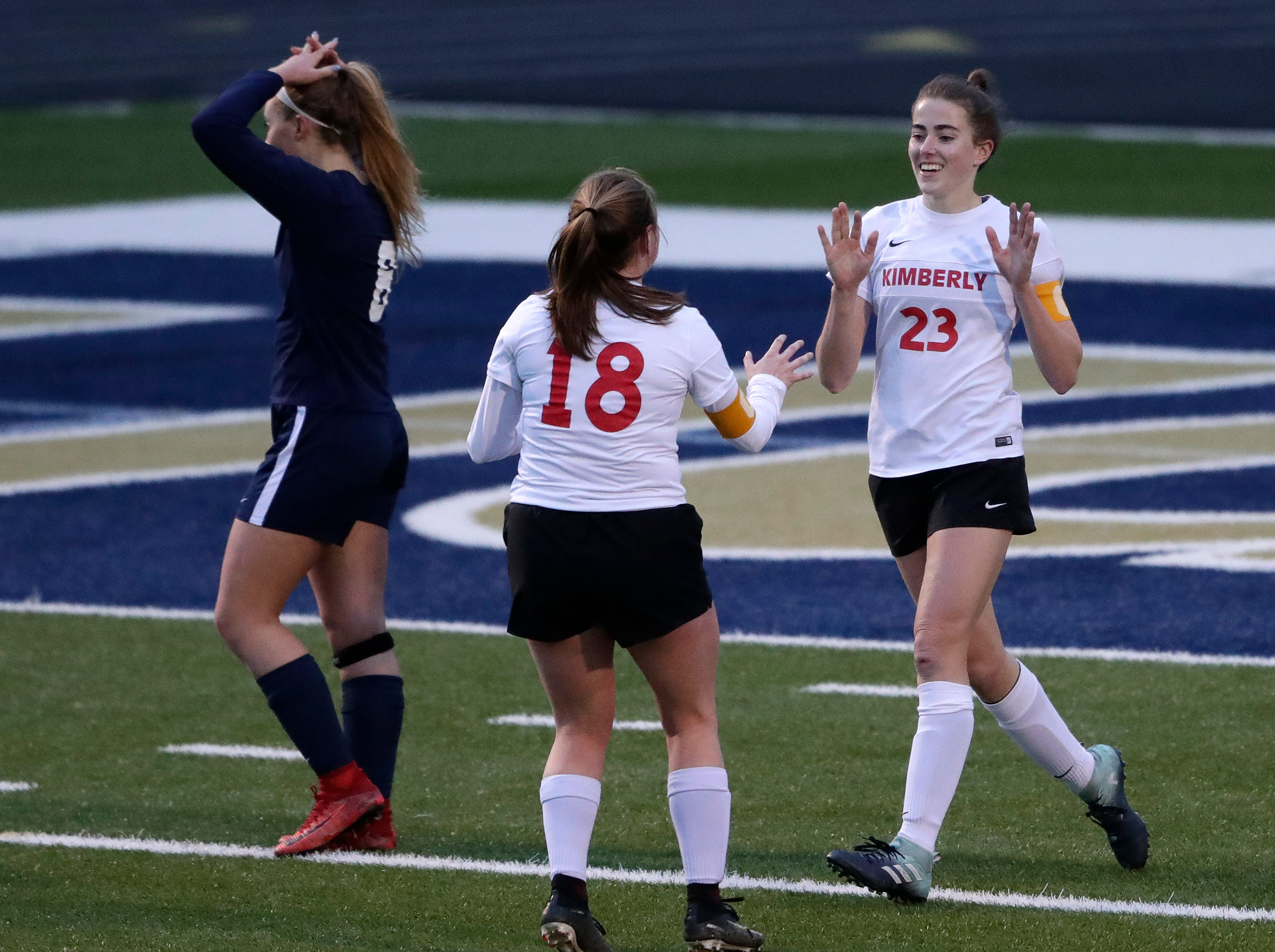 Kimberly High School's Elsi Twombly (23) celebrates scoring a goal with Lexi Huntington (18) against Appleton North High School's Elaina Anderson (8) during their girls soccer game Thursday, May 9, 2019, in Appleton, Wis. 