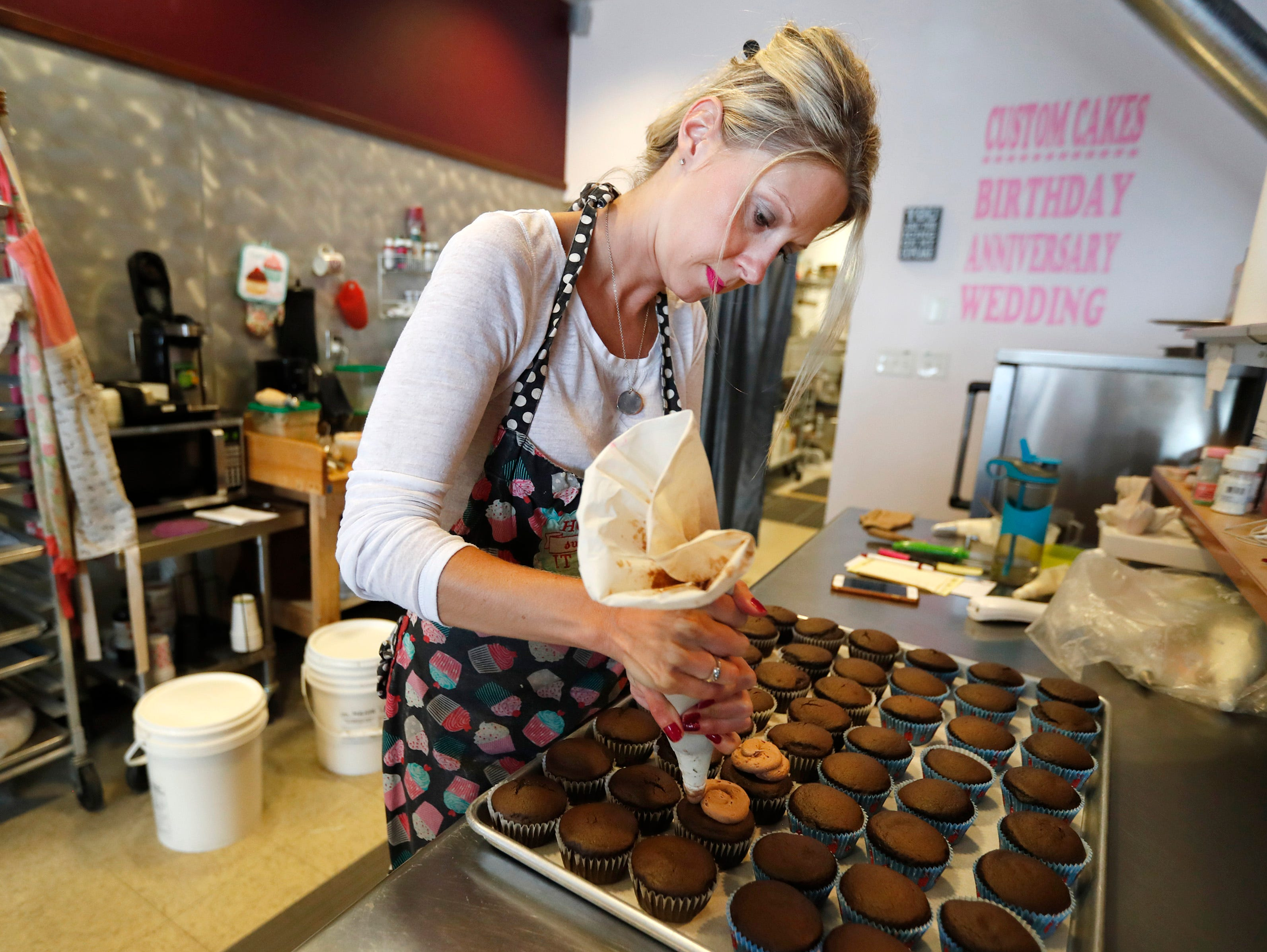 Rebecca Henry, owner of Rebecca's Sweets Boutique, frosts cupcakes that will be given away for free while supplies last on Friday May 10 as a promotion for Facebook's reveal of their new birthday stories Thursday, May 9, 2019, in Appleton, Wis. One bakery from each state was selected as part of the promotion.
