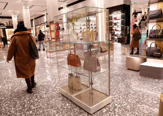 Saks Fifth Avenue shoppers pass through the luxury handbag section of Saks' flagship store in New York. Shopping can be a form of relaxation, an entertaining way to spend time or even a hobby. But it can turn into an expensive habit.