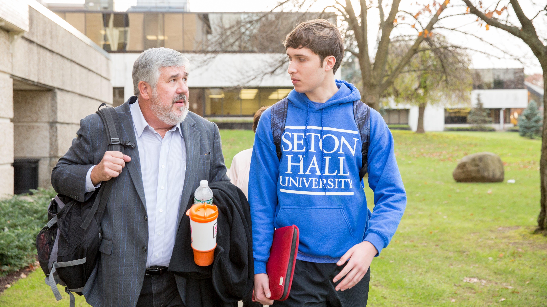 ESPN's Bob Ley (left) talks with a Seton Hall...