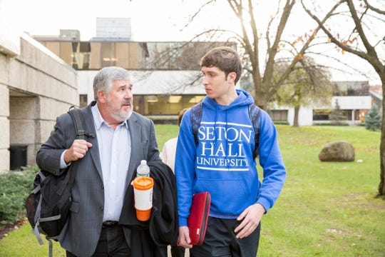 ESPN's Bob Ley (left) talks with a Seton Hall student while on campus to teach a master class earlier this school year.