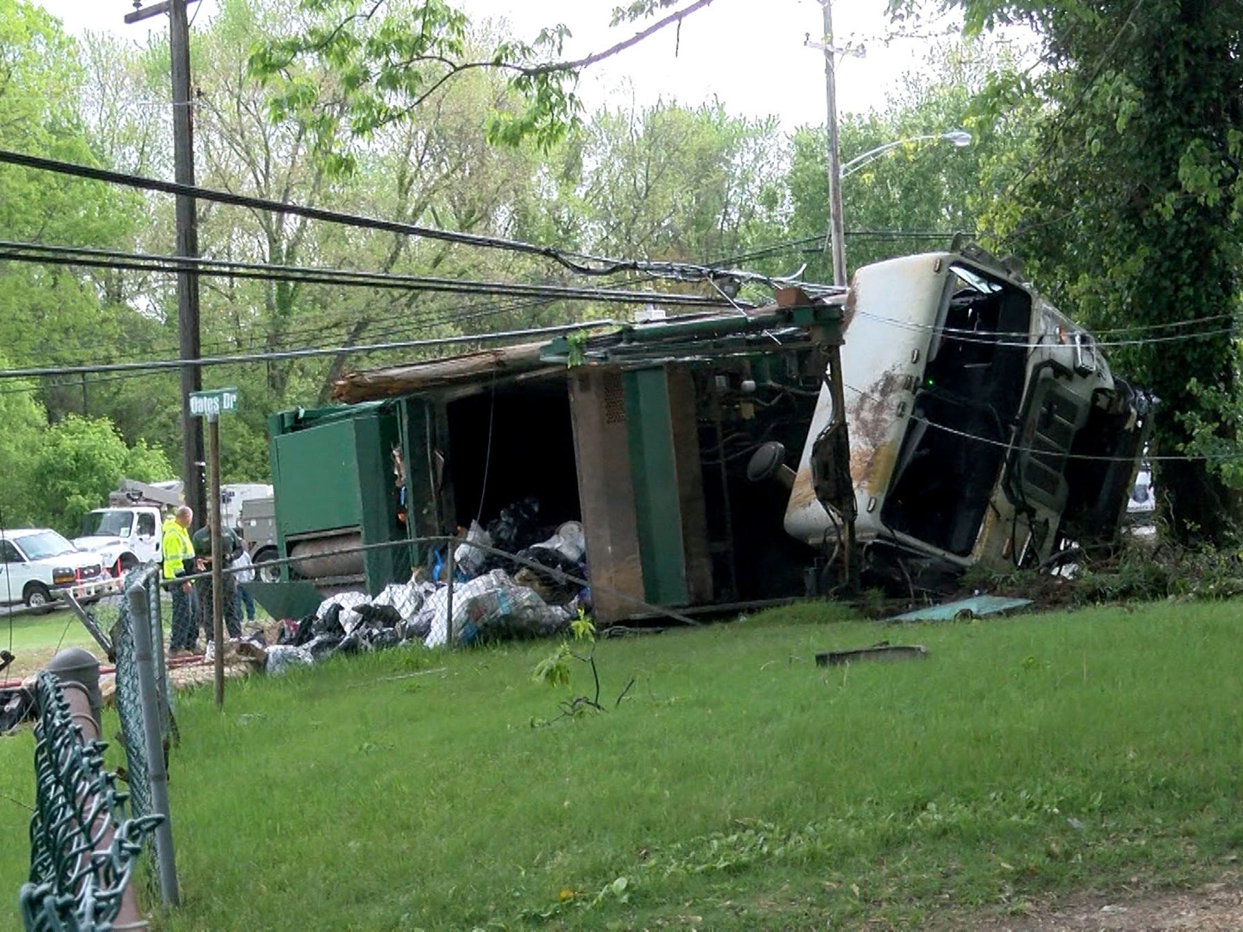 A Waste Management garbage truck overturned on West Farms Road at Casino Drive in Howell Township Tuesday morning, May 14, 2019.  At least two people were injured in the collison that spilled garbage on the roadway and cracked a poer pole.