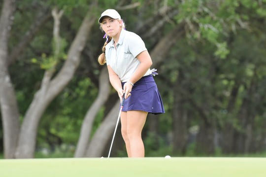 Wylie's Andrea Davis watches her putt on the No. 13 green during Tuesday's second round.