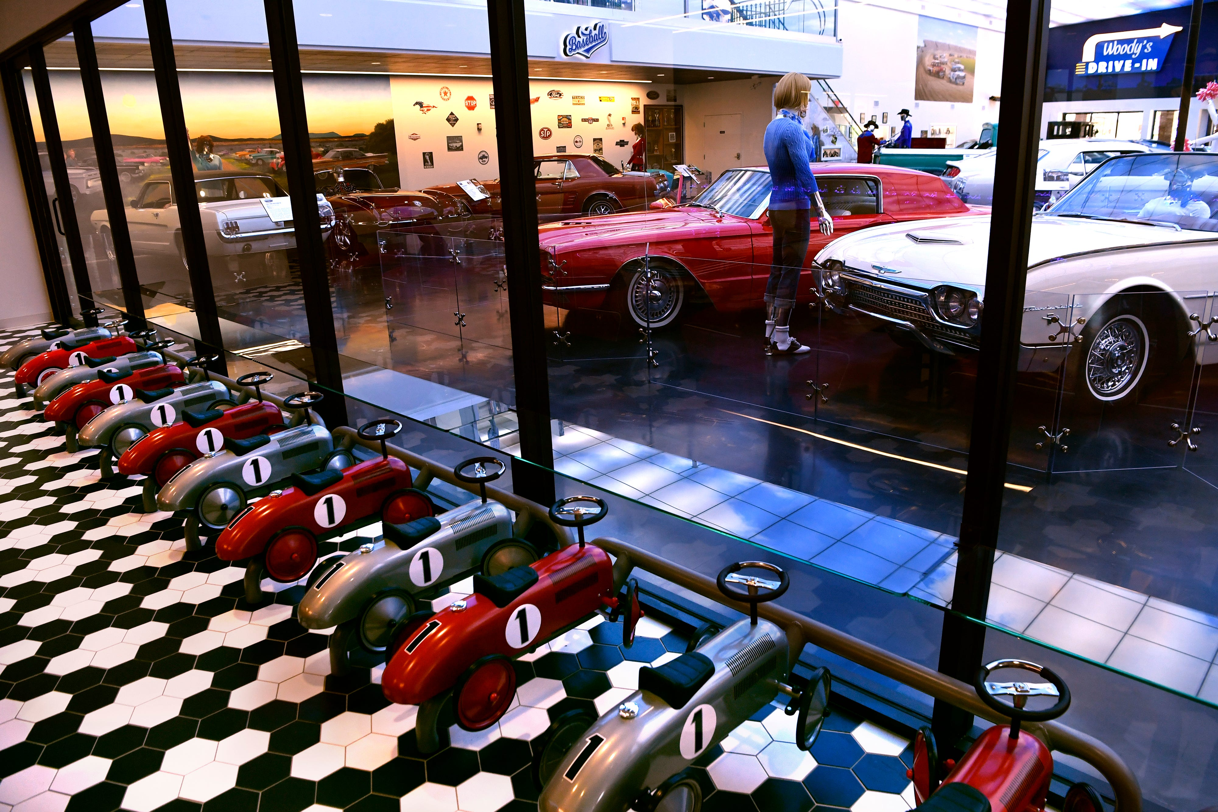 Racing car seats face outward toward the main museum floor inside the diner April 26, 2019 at Woody's Classic Cars and Baseball Museum in Cross Plains.