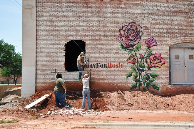 "Renovations are underway at a former grain storage building at 702 North Second St. on May 6. The new owners are planning a bakery and coffee bar in the newly named Heritage Building and have plans for honoring the ""Pray for Rosie"" mural."