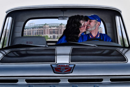 Patti Wood kisses her late husband Woody in this mural at the museum dedicated to his memory April 26, 2019. Woody's Classic Cars and Baseball Museum is located in Cross Plains.