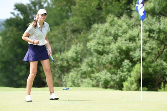 Wylie's Maddi Olson pumps her fist after sinking a putt for par on the No. 7 hole during the second round of the Class 5A state tournament at the White Wing Golf Club in Georgetown on Tuesday. Olson won the individual state title with a two-round 143.